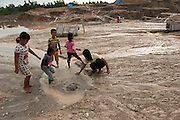 Miners sifting sand searching tin ore.  The entire Batako village works in the illegal mine, mere meters away from the homes.<br /> Illegal tin mine in Batako, Tunghin. Bangka Island (Indonesia) is devastated by illegal tin mines. The demand for tin has increased due to its use in smart phones and tablets.<br /> <br /> Mine d'étain illégale à Batako - Tunghin. <br /> L'île de Bangka (Indonésie) est dévastée par des mines d'étain sauvages. la demande de l'étain a explosé à cause de son utilisation dans les smartphones et tablettes.