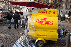 Tank containing Kvass alcoholic drink (made from fermented bread) at outdoor Eco-Market in Prenzlauer Berg , Berlin Germany