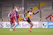 Tristan Abrahams of Newport County Bournemouth loanee Frank Vincent (23) of Scunthorpe United battles for possession during the EFL Sky Bet League 2 match between Scunthorpe United and Newport County at Glanford Park, Scunthorpe, England on 12 September 2020.