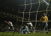 Photo: Andrew Unwin.<br />Newcastle United v Mansfield Town. The FA Cup.<br />07/01/2006.<br />Newcastle's Alan Shearer (L) wheels away after scoring his 200th club goal.