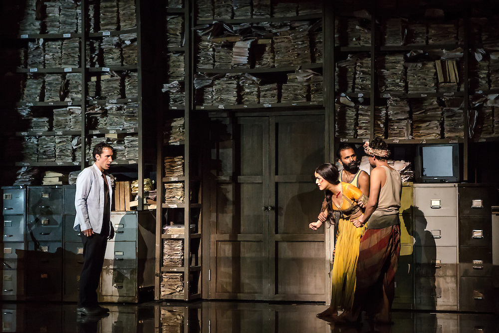 """LONDON, UK, 17 October, 2016.  Jacques Imbrailo (left, as """"Zurga"""") and Claudia Boyle (wearing yellow, as """"Leila"""") rehearse with members of the cast for the revival of director Penny Woolcock's production of Bizet's opera """"The Pearl Fishers"""" at the London Coliseum for the English National Opera.  The production opens on 19 October."""