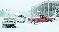 It was slow going through downtown Laconia Wednesday afternoon as the Nor'Easter stormed through the region dropping well over a foot of snow.  (Karen Bobotas/for the Laconia Daily Sun)