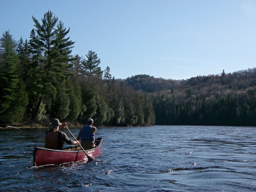 Canoeists on the Abinadong River in Ontario Canada