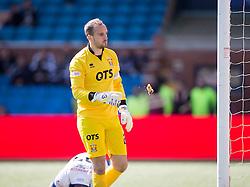Kilmarnock goalkeeper Jamie MacDonald eats the pie.  Kilmarnock 4 v 0 Falkirk, second leg of the Scottish Premiership play-off final.