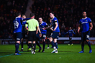 Oldham players, including Peter Clarke of Oldham Athletic (26), appeal to the referee after Peter Bankes (Referee) awards a penalty to Doncaster during the The FA Cup fourth round match between Doncaster Rovers and Oldham Athletic at the Keepmoat Stadium, Doncaster, England on 26 January 2019.