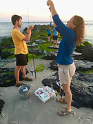 A couple prepares rods for ocean fishing at Cape May Point.