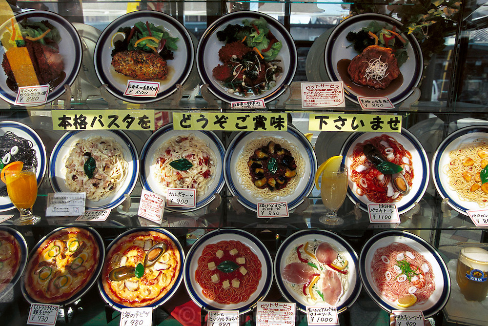 Plastic food in a restaurant window, Kobe, Japan. (From a photographic gallery of meals in Hungry Planet: What the World Eats, p. 245).