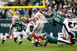 New York Giants quarterback Eli Manning #10 is sacked by Philadelphia Eagles defensive end Chris Clemons #91 during the NFL game between the New York Giants and the Philadelphia Eagles on November 1st 2009. The Eagles won 40 to 17 at Lincoln Financial Field in Philadelphia, Pennsylvania. (Photo By Brian Garfinkel)