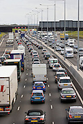 Traffic congestion in both directions on M25 motorway, London, United Kingdom
