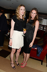 Left to right, EMMA WIGAN and LAETITIA CASH at a party to celebrate Ben Goldsmith guest-editing the July/August 2013 edition of Spears Magazine held at 45 Park Lane, London on 19th June 2013.