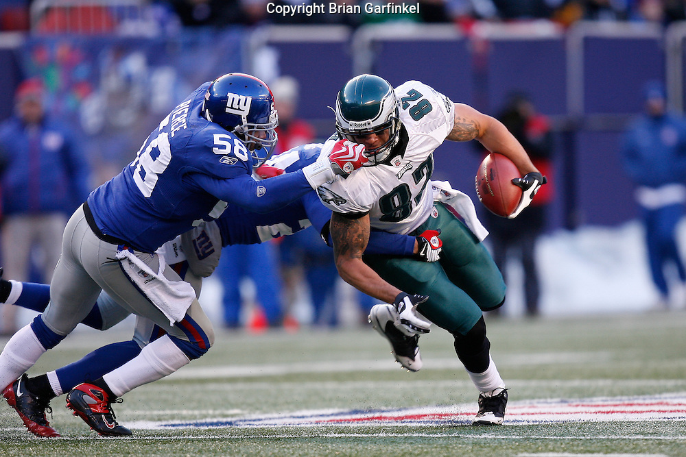 11 Jan 2009: Philadelphia Eagles tight end L.J. Smith #82 runs the ball and is tackled by New York Giants linebacker Antonio Pierce #58 during the game against the New York Giants on January 11th, 2009.  The  Eagles won 23-11 at Giants Stadium in East Rutherford, New Jersey.
