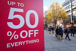 © Licensed to London News Pictures. 05/12/2020. LONDON, UK.  A discount sign seen by shoppers in Oxford Street on the first Saturday after lockdown restrictions were lifted on 2 December.  Retailers are hoping that physical sales will pick up in the run up to Christmas.  This comes against a backdrop of two major retailers Debenhams and Arcadia, owner of Topshop, collapsing into administration in the last week.  Photo credit: Stephen Chung/LNP