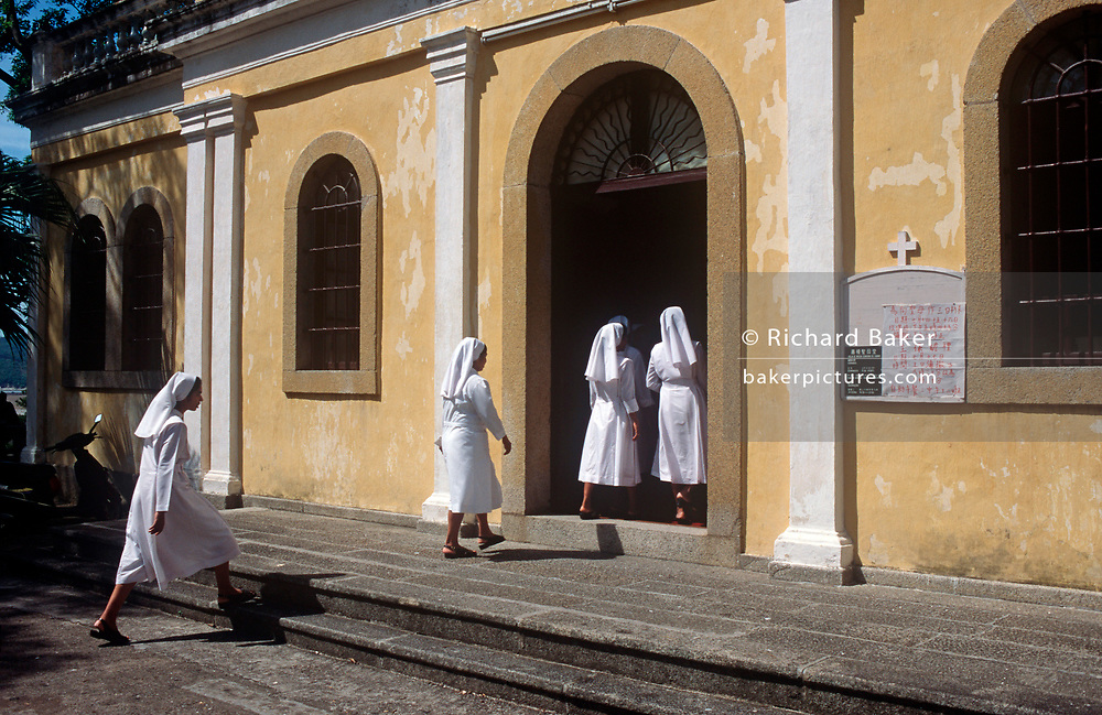 While still a Portuguese colony, Catholic nuns in the 190s enter the Church of Our Lady of Carmel in Macau, on 10th August 1994, in Macau, China. (Photo by Richard Baker / In Pictures via Getty Images)