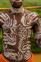 Kara tribe man with elaborate chalk painting on his body, Dus village, Omo Valley, Ethiopia.