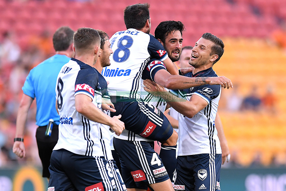 December 17, 2017 - Brisbane, QUEENSLAND, AUSTRALIA - Rhys Wiliams of Melbourne Victory (4, 2nd from right) celebrates with team mates after scoring a goal during the round eleven Hyundai A-League match between the Brisbane Roar and the Melbourne Victory at Suncorp Stadium on Sunday, December 17, 2017 in Brisbane, Australia. (Credit Image: © Albert Perez via ZUMA Wire)