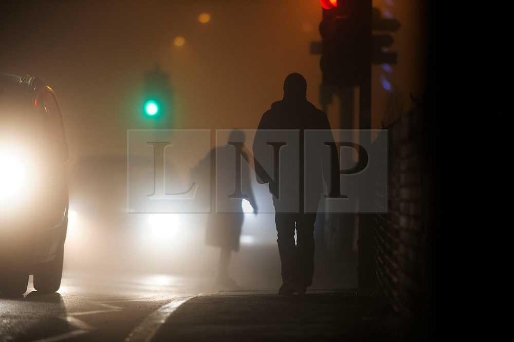 © Licensed to London News Pictures. 27/11/2020. <br /> New Eltham, UK. Fog in New Eltham, London as commuters walk to work. Freezing foggy weather conditions this Friday morning across large parts of the UK. Photo credit:Grant Falvey/LNP