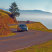 Sightseers drive their cars along winding Ridgecrest Boulevard, above the Pacific Ocean on the the slopes of Mount Tamalpais, north of San Francisco in California's Marin County.