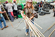 May 2 - BANGKOK, THAILAND: A Red Shirt protestor carries bamboo stakes and spears to the new Red Shirt barricades. The Red Shirts moved  their barricades in the Sala Daeng Intersection in Bangkok Sunday further away from King Chulalongkorn Memorial Hospital after a threat that the government would move them out if they didn't move themselves. The stand off between the Red Shirts and the government enters its third month in May. The Red Shirts continue to call for Thai Prime Minister Abhisit Vejjajiva to step down and dissolve parliament and demand the return of ousted Prime Minister Thaksin Shinawatra.   PHOTO BY JACK KURTZ