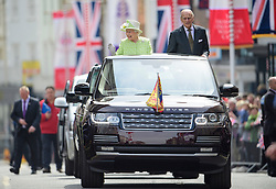 ©  London News Pictures. 21/04/2016. Windsor, UK. HRH QUEEN ELIZABETH II in an open top Land Rover with PRINCE PHILIP during a drive through the town of Windsor, Berkshire on the day of her 90th birthday.  Photo credit: Ben Cawthra/LNP