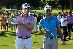 September 24, 2017 - Atlanta, Georgia, United States - Justin Thomas (L) winner of the FedEx Cup and Xander Schauffele holds the Calamity Jane trophy after the final round of the TOUR Championship at the East Lake Club. (Credit Image: © Debby Wong via ZUMA Wire)