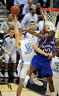 5 APR 2008: Darrell Arthur (00) of the University of Kansas and  Tyler Hansbrough (50) of the University of North Carolina clash during semifinal game of the 2008 NCAA Final Four Division I Men's Basketball championships held at the Alamodome in San Antonio, TX.  Kansas defeated North Carolina 84-66 to advance to the championship game.  Brett Wilhelm/NCAA Photos