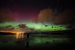 © Licensed to London News Pictures. 06/03/2016. Seahouses, UK. Aurora borealis seen vividly over the north east coast at Seahouses, Northumberland, UK on March 06, 2016. Known as the 'northern lights' the polar light creates a spectacular show of bright colours in the sky. Photo credit: Mark Hume/LNP