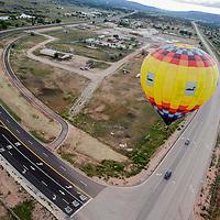 A hot air balloon lifts off over Zuni during the Zuni Fair Saturday in Zuni.