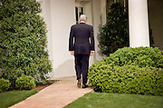 President Bill Clinton walks back to the Oval Office after addressing reporters behind the Oval Office about his discussions with Congressional leaders on the Kosovo situation April 28, 1999. The president reaffirmed his commitment to support NATO military actions in coming months.