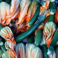 USA, California, Los Angeles. Locally grown orgainc squash blossoms at the Hollywood Farmer's Market.