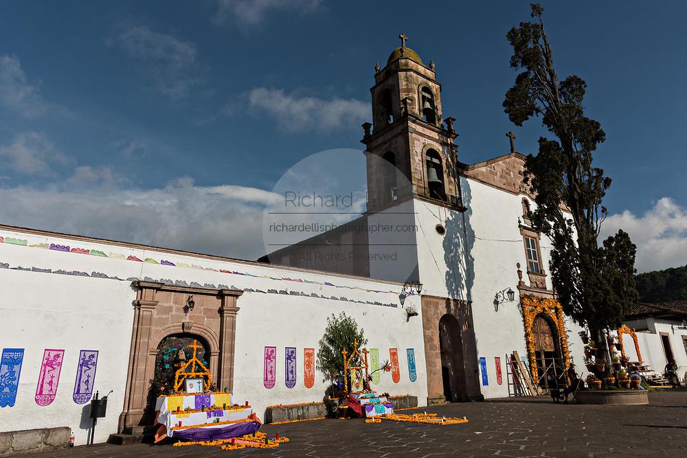 The Templo de Nuestra Señora del Sagrario church with Day of the Dead altars decorated with marigolds in Santa Clara del Cobre, Michoacan, Mexico.