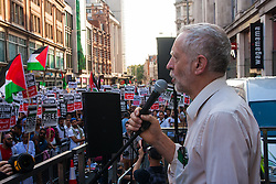 London, July 22nd 2014. Jeremy Corbyn MP addresses the crowd as many hundreds of Palestinians and their supporters demonstrate outside the Israeli embassy in London, against the rising death toll in the ongoing ground offensive by Israel in Gaza.