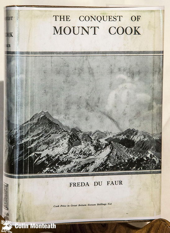 THE CONQUEST OF MOUNT COOK - FREDA DU FAUR, George Allen & Unwin, London, First Ed., 1915, Very scarce facsimile jacket,  original tan cloth & gilt titles, gilt is fine though background black faded/speckled, tan boards sound though some warping on back, internally some foxing otherwise fine, Classic account of Freda's climbs in New Zealand including first grand traverse of Aoraki / Mount Cook with Peter Graham. This copy owned by Bill Denz & signed by Bill on fep. $NZ600.