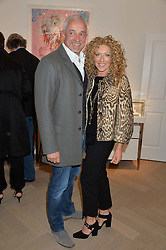 KELLY HOPPEN and JOHN GARDINER at a party to celebrate the launch of the new Stephen Webster Salon at 130 Mount Street, London on 18th May 2016.