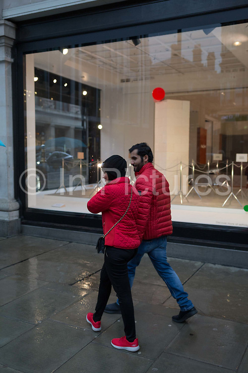 Shoppers walk past a window display that is part of a design theme called State of the Arts, at the Selfridges department store on Oxford Street, on 4th March 2019, in London England. State of the Arts is a gallery of works by nine crtically-acclaimed artists in Selfridges windows to celebrate the power of public art. Each of the artists are involved in creating a site-specific artwork at one of the new Elizabeth line stations as part of the Crossrail Art Programme.