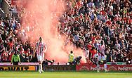 Dejected Stoke players look on as Liverpool fans set off a flare .Premier league match, Stoke City v Liverpool at the Bet365 Stadium in Stoke on Trent, Staffs on Saturday 8th April 2017.<br /> pic by Bradley Collyer, Andrew Orchard sports photography.