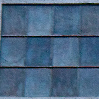 Mosaic windows in hues of blue mimic ceramic tiles, framed by a starburst frieze.
