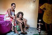 "Muna is combing Tina's hair; the two Ethiopians prostitutes will soon be heading to a club. ""The best is to find an American soldier,"" says Tina. ""The French are the most generous clients; they pay for our apartments so that we don't have to work. But sooner or later, they all go back to their wives."" ..One of the communal home of escort girls and prostitutes, in Djibouti. Most of them find their clients in bars and discos. Most of their clients are military people and workers from various nationalities. Prostitute are most of the time high on Khat, a stimulant drug...The geostrategical and geopolitical importance of the Republic of Djibouti, located on the Horn of Africa, by the Red Sea and the Gulf of Aden, and bordered by Eritrea, Ethiopia and Somalia."