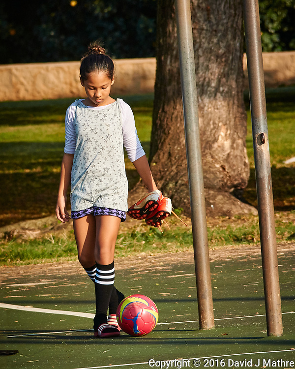 Girl returning from soccer practice. Image taken with a Nikon N1 V3 camera and 70-300 mm VR lens
