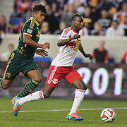 Bradley Wright-Phillips, (right), New York Red Bulls,  is challenged by Rauwshan McKenzie, Portland Timbers, during the New York Red Bulls Vs Portland Timbers, Major League Soccer regular season match at Red Bull Arena, Harrison, New Jersey. USA. 24th May 2014. Photo Tim Clayton