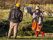 Campesino woman flirts with man at Camp 4 at 3700 meters elevation in Jancapampa Valley, in the Cordillera Blanca, Andes Mountains, Peru, South America. Day 4 of 10 days trekking around Alpamayo in Huascaran National Park.