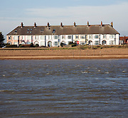 Houses at Felixstowe Ferry, mouth of the River Deben from Bawdsey, Suffolk, England