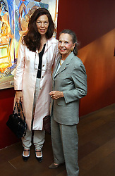 Left to right, JENNY WILHIDE and actress LESLIE CARON at a private view of artist Damian Elwes work 'Artists Studios' held at Scream, 34 Bruton Street, London W1 on 29th June 2006.<br />