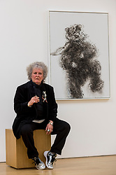 """© Licensed to London News Pictures. 14/10/2020. LONDON, UK. Artist Maggi Hambling poses with her work """"Young dancing bear"""", 2019, at the preview of Maggi Hambling: 2020 at Malborough Gallery in Mayfair.  The exhibition of recent paintings coincides with Hambling's 75th Birthday and runs 15 October to 21 November 2020.  Photo credit: Stephen Chung/LNP"""