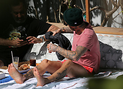 EXCLUSIVE: *NO WEB UNTIL 2PM GMT 29TH JAN* English former professional footballer David Beckham is seen shirtless in a red bathing suit and a beanie while enjoying some time by the pool in Miami Beach, Florida. Beckham is in Miami to reportedly announce his Major League football team on Monday. 27 Jan 2018 Pictured: David Beckham. Photo credit: MEGA TheMegaAgency.com +1 888 505 6342