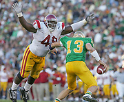 USC's Sedrick Ellis swarms Notre Dame quarterback Evan Sharpley and completes one of several sacks by the Trojans.