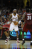 LeBron James of Cleveland is guarded by Ricky Davis..The Miami Heat lost to the host Cleveland Cavaliers 84-76 at Quicken Loans Arena, April 13, 2008...