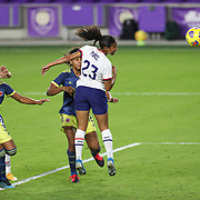 ORLANDO, FL - JANUARY 22:  Margaret Purce #23 of United States heads the ball for a goal as Daniela Arias #3 of Columbia and Jorelyn Carabali #16 of Columbia look on at Exploria Stadium on January 22, 2021 in Orlando, Florida. (Photo by Alex Menendez/Getty Images) *** Local Caption *** Margaret Purce;Daniela Arias; Jorelyn Carabali