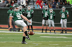18 October 2014:  Matt Kussmann (DL/P) punts the ball away during an NCAA division 3 football game between the Augustana Vikings and the Illinois Wesleyan Titans in Tucci Stadium on Wilder Field, Bloomington IL