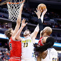 22 November 2016: Denver Nuggets center Jusuf Nurkic (23) goes to the basket against Chicago Bulls center Robin Lopez (8) and Chicago Bulls forward Taj Gibson (22) during the Denver Nuggets 110-107 victory over the Chicago Bulls, at the Pepsi Center, Denver, Colorado, USA.