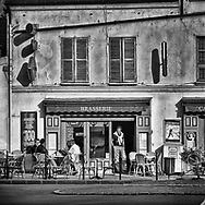 Saturday morning at the local sidewalk cafe in Marly, France.  Aspect Ratio 1w x 0.667